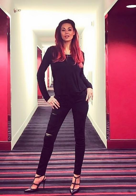 Actress Tera Patrick poses in the D Casino Hotel hallway