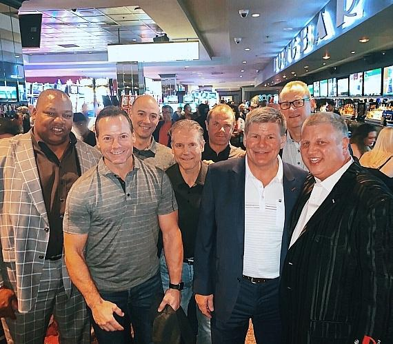 Calgary Flames coaches Martin Gelinas, Ryan Huska, Geoff Ward, Bill Peters and Brad Treliving with Darren Banks (R) Casino Owner Derek Stevens (L) Longbar At The D Hotel Las Vegas