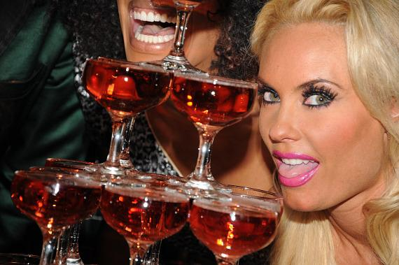 Coco Austin with champagne