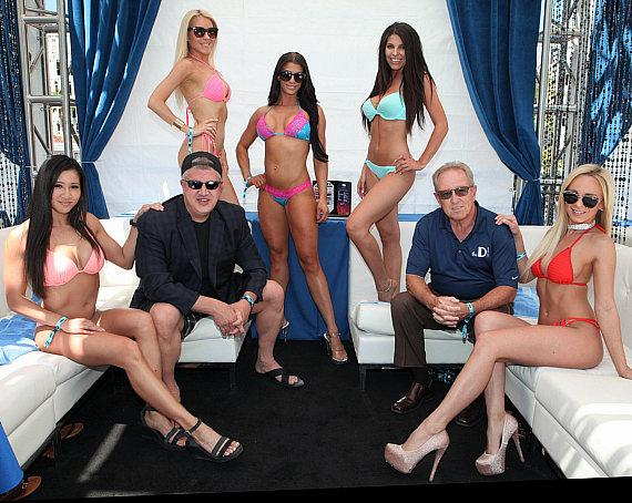 Downtown Las Vegas Events Center Owner Derek Stevens with Chief Operating Officer David Tuttle and Bikini Models at DirtyBird BBQ Festival