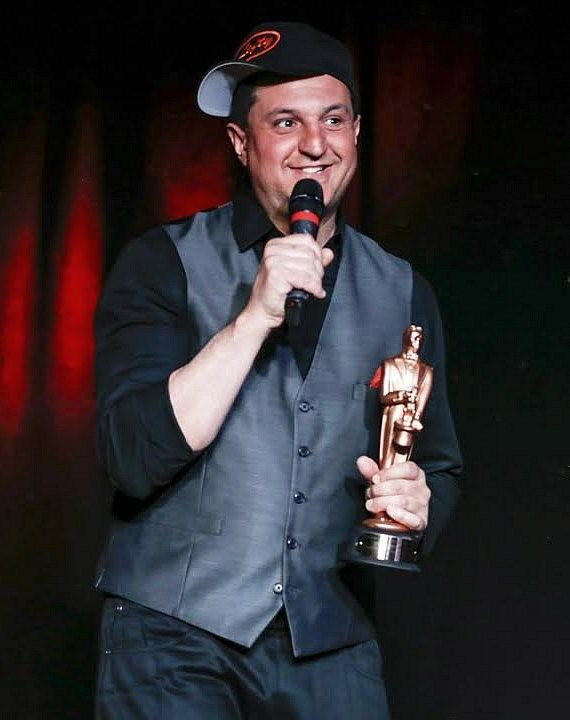 """Douglas 'Lefty' Leferovich, after receiving """"World Champion Magician Award for Manipulation"""" from Tony Hassini, President of the International Magicians Society"""