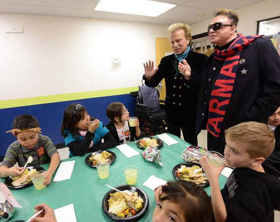 Siegfried & Roy with kids at The Boys & Girls Clubs Of Southern Nevada's Downtown Clubhouse