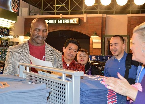 Evander Holyfield talks with fans in the SCORE! gift shop