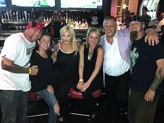 Counting Cars stars Horny Mike (r) and Ryan Evans (l) with the D Owner Derek Stevens (2nd from right) and his wife Nicole (3rd from right) and friends at the D Casino Hotel Las Vegas