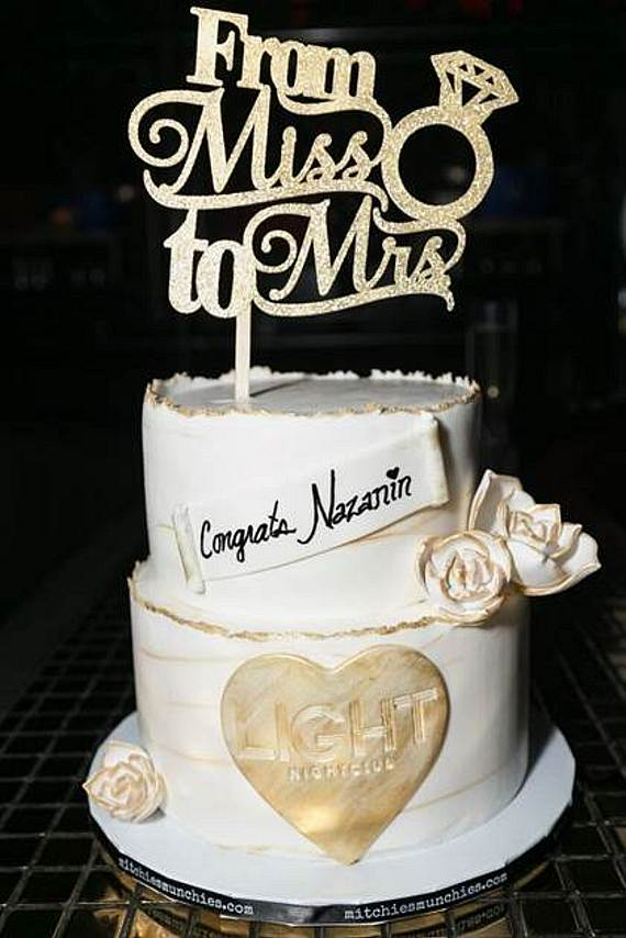 "Naz was surprised with a two-tier congratulations cake that read ""From Miss to Mrs."""
