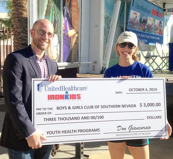UnitedHealthcare of Nevada chief medical officer, Dr. Laurine Tibaldi, presents a $3,000 cheque to Brian Knudson, president, Boys & Girls Clubs of Southern Nevada, to support the Club's healthy living programs.