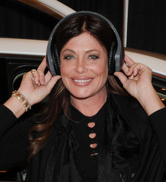 Kelly LeBrock models headphones in Velodyne Acoustics Booth at CES