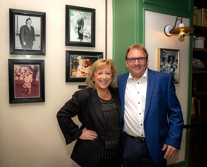 Flamingo Las Vegas founder Meyer Lansky's grandson, Meyer Lansky II and wife Dani, in front of historical family photos, which can be seen upon entering Bugsy & Meyer's Steakhouse. Photo credit: Erik Kabik