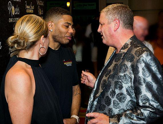 Nelly with Casino Owner Derek Stevens and his wife Nicole in Las Vegas