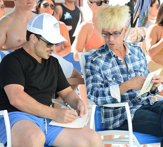 Celebrity judges Mark Shunock and Murray SawChuck tally up the points and make their final decision.