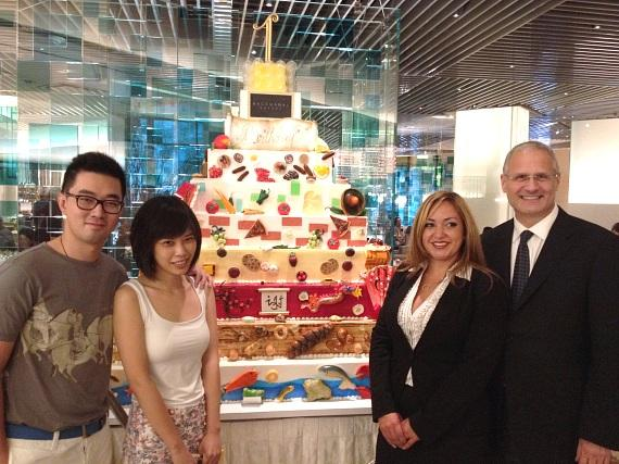 Yao Cheng, One-Millionth Guest Tianshu Sun and President of Caesars Palace Gary Selesner at Bacchanal Buffet at Caesars Palace