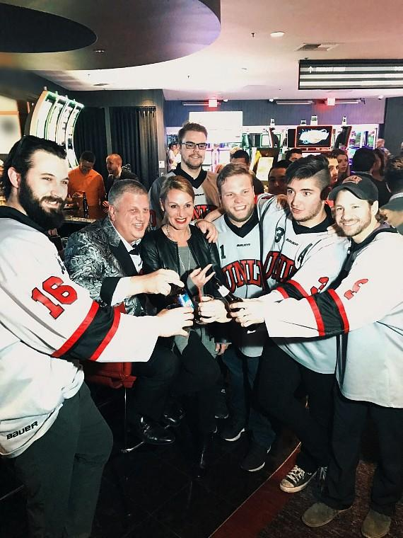 The D Casino Owner Derek Stevens with wife Nicole Parthum and UNLV Hockey Players