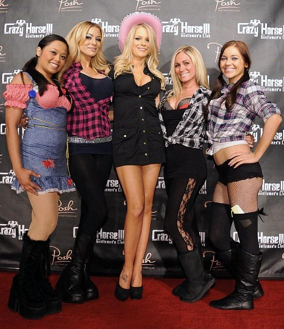 """Tiffany Selby and beautiful cocktail servers at Crazy Horse III's """"Babes & Buckles"""" bash"""