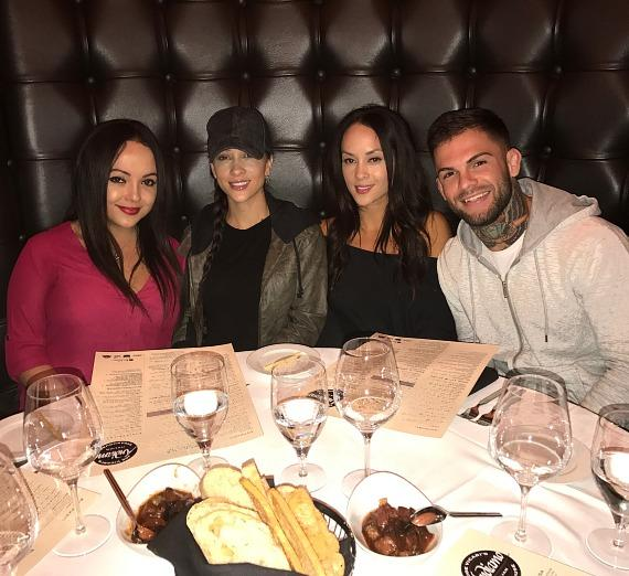 "UFC Champion Cody ""No Love"" Garbrandt with girlfriend Danny Pimsanguan and sisters Lena Pimsanguan and Natalie Pimsanguan at Andiamo Italian Steakhouse Las Vegas"