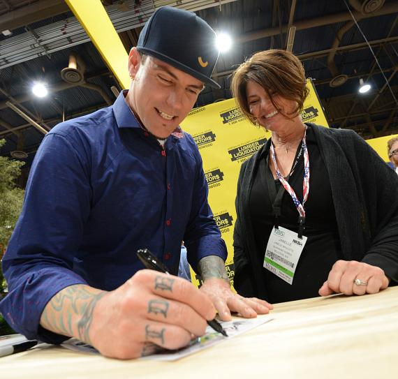 Vanilla Ice signs autograph for fan at NAHB International Builders Show in Las Vegas