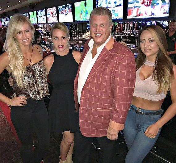 WWE Emma and Summer Rae pose with The D Casino Owner Derek Stevens and his wife Nicole in Las Vegas