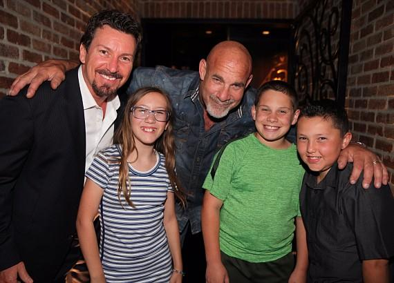 WWWE Legend Goldberg posing with son, Gage Goldberg, and the Wilk Kids