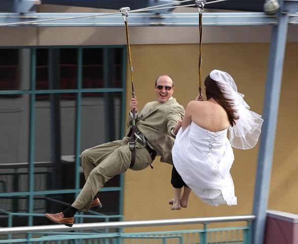 Bride and groom zipline down Fremont Street